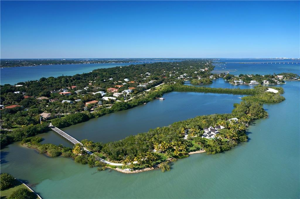 The private island retreat of your dreams is located in the coveted Sewall's Point community. A tropical oasis with its tranquil blue waters, sandy white beaches, swaying palms and perfect southeastern exposure begins to paint a picture of the island lifestyle. Once in a lifetime does an uber-property like this come on the market. The property offers deep water and is accessed by a private bridge and offers 2,700+/- ft. of shoreline surrounding the 3.4+/- acre island with