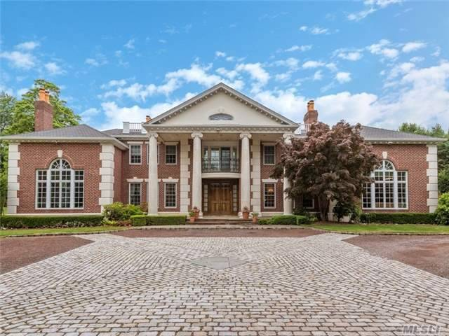 Richly Detailed Georgian Colonial Situated On A Private Cul-De-Sac Overlooking The Historical Polo Fields Of Old Westbury. Embodied With Stature And Grace, This 6 Bedroom Residence Offers A Dramatic 2 Story Foyer, 12'Ceilings,Theater & Handsome Library. Resort Style Amenities On The Emerald 6.7 Acres Include Pool,Waterfall,Hot Tub And Golf Hole. Generator. Jericho Sd.
