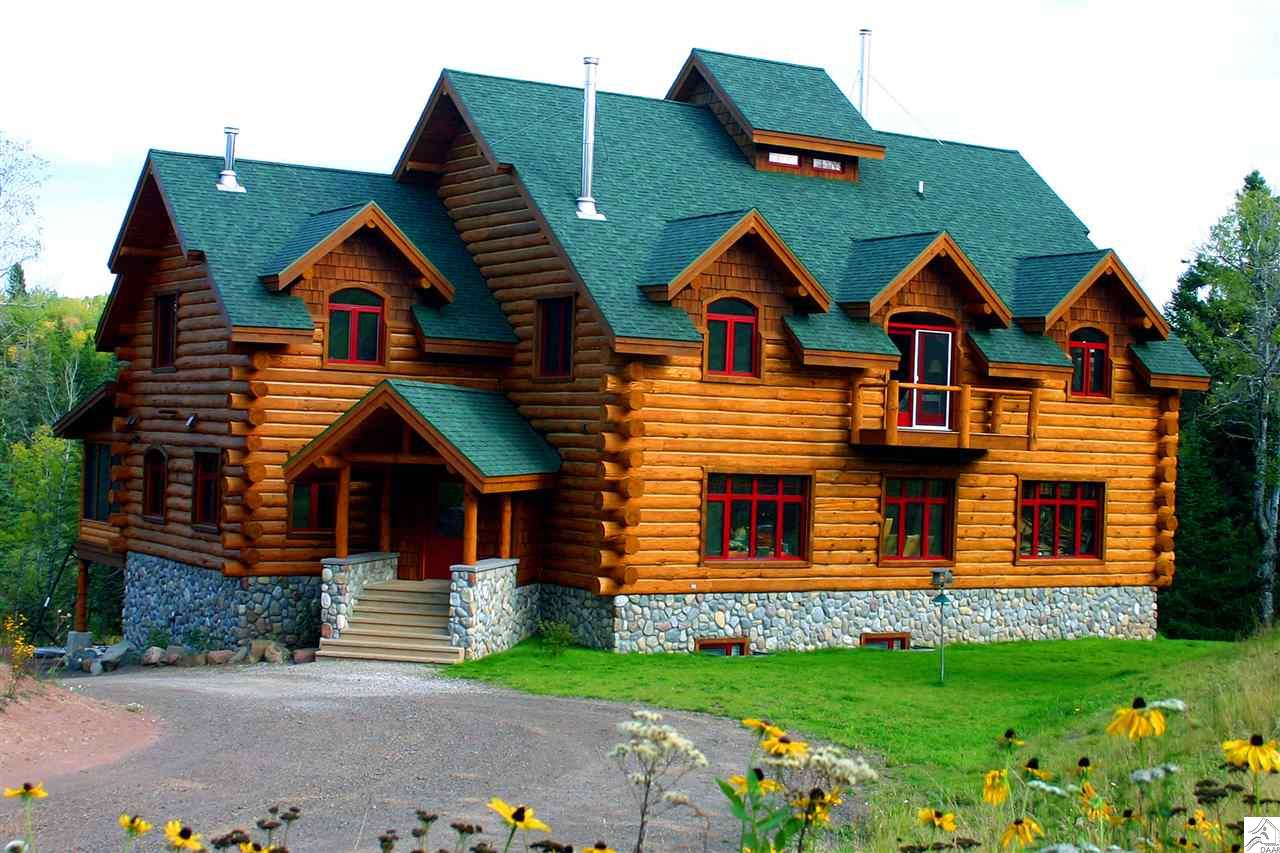 "Bed & Breakfast, Home or Family Retreat? Dreamed of living on Minnesota's North Shore? This spectacular property is your opportunity to escape the rat race. Excellent, established business with plenty of opportunity for additional expansion and development. Situated on 32 very private wooded acres. A spectacular 1/4 mile stretch of the Baptism River is yours on both banks. Turnkey B&B rated 5 stars and awarded Travelers Certificate Of Excellence 5 years running. Close to everything ""Up North,"" minutes from Lake Superior, 8 miles to town and light years from hectic. Custom designed as a B&B with attention to every detail. High quality furnishings are included in sale. Since we are very busy with B&B guests, the property will be shown by appointment only to seriously interested and financially qualified buyers. Thanks for your understanding."