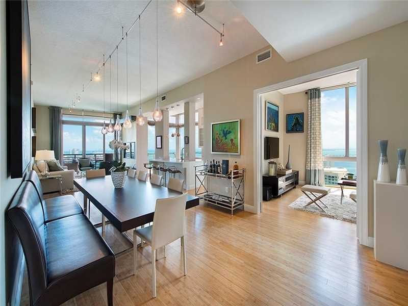 Completely renovated lower penthouse w/12 ft. ceilings in a waterfront building Downtown. Step out onto a large wraparound balcony & enjoy unobstructed views of the ocean, Biscayne Bay & Port of Miami. Top of the line custom finishes throughout including bamboo flooring & state-of-the art kitchen appliances & electronics. Assigned covered parking space on 1st fl. Enjoy sundeck, 2 pools, 2 gyms, convenience store & 2 famous restaurants, Il Gabbiano & Wolfgang's. Close to renowned new Brickell City Center!