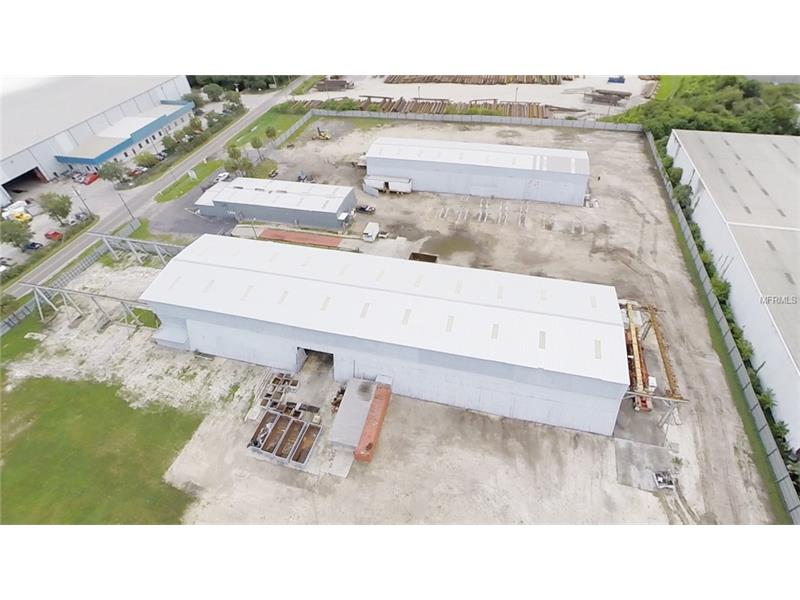 3-building industrial campus with 39,035 SF total building space, 2 bridge crane systems and truck scale on 5.7 Acres of fully-security-fenced land located adjacent to rail and zoned M (Manufacturing) Hillsborough County. Site is <2 M from Port of Tampa; 4 M to I-75; and 3.2 M to I-4! West Building is 275' x 79' w/32' clear height (21,725 SF), and partially shelters a 400' x 56' x 24'H bridge crane system.  The crane extends 100' out of the building to the north and 25' to the south.  The East building is 200'x 60' w/24' clear height (12,000 SF), and completely shelters a 200'x 39' bridge crane system.  The center main building is 125' x 40' w/14' clear height (5,000SF) plus office 19' x 40' (760SF).  Seller did not use the bridge crane systems and does not warrant their usability.  The functional truck scale is 72' x 11'. The property is completely fenced with solid, galvanized steel panels providing both site security and street level visual privacy.  The fence has some components in place for electric security measures.   Seller did not use the electric fence and does not warrant its usability.  The 5.7 acre parcel is approx. square at ± 465' x 472'.  It is flat, clear, and ready to use. Owner previously quoted $100K for rail spur.  The M (Manufacturing) zoning permits a wide variety of uses (see attached zoning docs).  Future Land Use (FLU) is LI (Light Industrial), Hillsborough County. NOTE: includes 2 parcels 5209 (U-27-29-19-663-000001-58400.0) and 5211 (U-27-29-19-663-000001-58390.0) 24th Ave S.