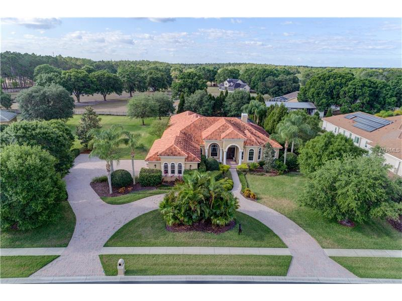 "Mediterranean estate perfectly situated on an acre of luscious landscaping in the sought after Northbridge at Lake Pretty! This attractive home boasts appointments including a brick pavered driveway and walk way leading up to the elevated, front veranda to the Mahogany double door entrance to the grand, cathedraled foyer w/custom lighting and circular rotunda ceiling, formal living room w/stone faced wood burning fireplace, stone trimmed art niches and triple sliders, chef's kitchen with granite center island, countertops and breakfast bar, coffered ceilings, custom hood vent, stainless steel Thermador appliances, goose neck faucet, maple cabinetry w/self-hinging drawers, travertine backsplash, recess lighting and breakfast buffet, eat in space offers custom lighting and gorgeous views through the mitered glass windows overlooking the screened, PebbleTec finished pool w/stone coping and 8 person spa, family room w/surround sound, built in entertainment cabinetry, double tray ceilings and triple sliders, vast master bedroom w/double tray, crowned ceilings, plush carpeting and his/her walk in closets, immense master bath w/stained maple cabinetry, granite countertops, custom lighting and mirrors,  plantation shutters, make-up vanity, walk in shower and garden Jacuzzi tub, French door entry into the study w/hardwood flooring, chair railing, coffered wood trimmed ceilings and built in desk, wondrous game room w/crown molding and amazing views, 8"" crown molding and base boards, landscape lighting and more!"