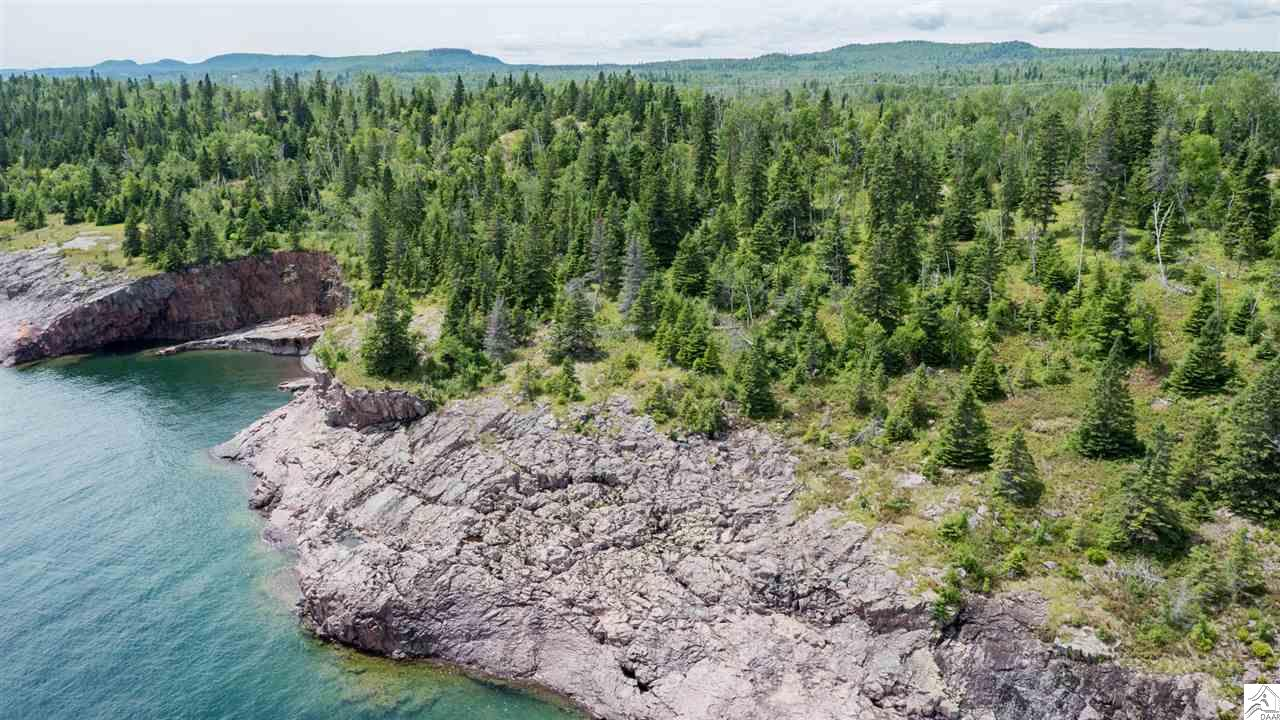 One of a kind!! 50 acres Lake Superior property with over 2000 feet of shoreline. Perfect for private retreat or subdivision or land development! The possibilities are endless with this gorgeous piece of property! Located 70 miles north of Duluth with roadway access, this property is private and quiet. Sitting peacefully on the Bluffs of Lake Superior it is unmatched for it's rugged charm and beauty.  To see a video on this property, copy and paste this link.  http://vimeopro.com/nonenone/50acres