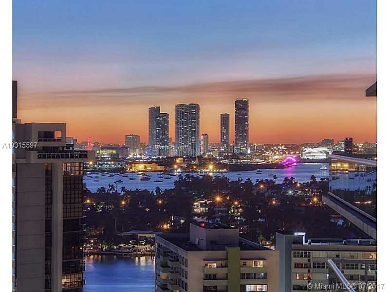 Simply breathtaking, ultra-modern 4,750 sq. ft., 2-story corner loft Penthouse, creme de la creme of SoBe living. Move into this totally renovated chic featuring: 3B/3.5BA, 20ft double height ceilings, gourmet kitchen w/ custom cabinetry, Miele & Sub Zero appl, 2 dishwashers, 2 wash/dryer, wine vault, Crestron & Lutron systems, wraparound terrace & almost 360 degree unobstructed views of Bay, SoBe skyline & Islands. Upstairs master suite offers sitting area, master spa bath, SS fireplace, 2 huge walk-in c