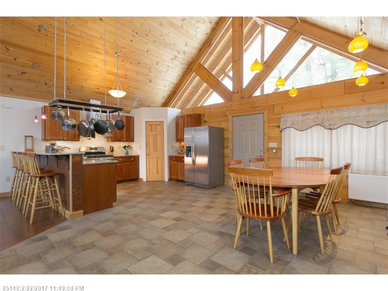 MOTIVATED SELLER! High end log home loaded with premium features. New finished basement with a living room and bedroom/home theater. Gorgeous granite kitchen with solid cherry cabinets. Cathedral ceilings and sunny open floor plan. Finished heated 4 car garage. Fenced yard