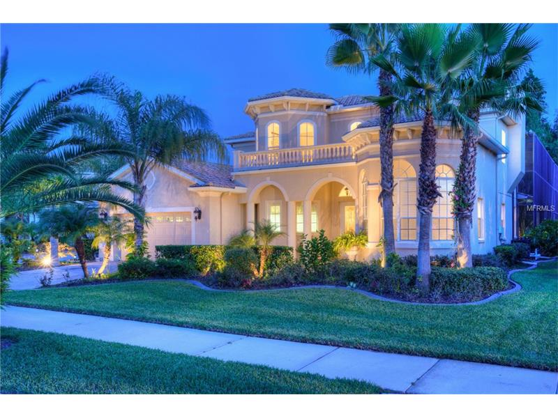 """Picture yourself in a luxurious tropical inspired home in gated Cory Lake Isles. Looking for a home with all the upgrades? In the sought after """"The Point"""" area.  2 story, 4 Bed + Bonus/flex space (could be 5th bedroom), 3.5 baths, 2 car.  Custom pool area w/cabana inspired sitting area plus another off the family room, outdoor kitchen with custom tile wall, and 2 story screen enclosure over an enormous pool. As you enter the home soaring ceilings greet you. 1st bedroom on your right w/ full bath, ½ bath in hall, leading through the formal living area, siders to the pool area & wood burning fireplace. The formal dining is accentuated w/ columns & a custom arbor view. The family room w/conservation views joins the chef's kitchen w/granite counters, island, breakfast bar, stainless appliances & upgraded cabinets.  Two bedrooms are located just off the family room. The solid wood staircase leads to you an oversized bonus room (could be a bedroom) & a spectacular Master suite w/wood floors, tray ceiling, private screened balcony, huge walk in closets, a glamorous spa bath w/ walk through shower, duel sink/cabinet areas w/a garden soaking tub centered in between. Cory Lake Isles amenities include: Resort pool and bath house, Beach Club, tennis, roller hockey, basketball, gym, & pocket parks. Close to gourmet restaurants, shopping, medical centers & more. Prepare yourself to be amazed!"""