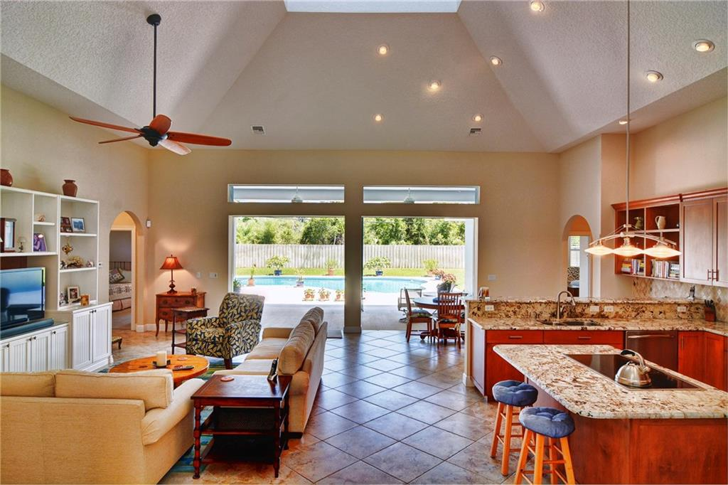 Beautiful and immaculate Rocky Point pool home built in 2008 with 4 car garage and deeded rights to the Pioneer Club boat ramp. Only 5 minutes to the Inlet. You'd think this fabulous home was brand new! Light & bright great room has wonderfully high ceilings and an open kitchen with built-in entertainment center. The kitchen features optional gas hookup at the island cook top, granite counters, stainless steel appliances, spacious pantry and built-in desk. Enjoy the summer kitchen and heated pool in the privacy of your fully fenced backyard. The office can easily be converted to a 4th bedroom with the addition of a closet. Plenty of room for all your toys in the 4-car garage with a separate workshop area for your tools. The home has loads of extra storage space and must be seen to be appreciated.