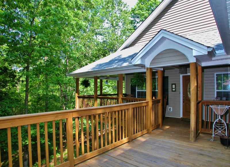 This tree house is a charmer! Privacy and peacefulness. Large wrap around porch, master suite, dining room, kitchen with a view to family room, and office/2nd bedroom on main level, finished terrace, new Murphy bed, 2nd family room, and large flex space/bedroom, patio, gardens & outbuilding.