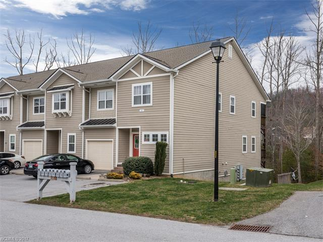 Great upper end unit with views of club house and pool. Main level entrance,unit is on second floor.  Split bedrooms with lots of natural light. Private screened deck. Lots of parking. In move in condition. Close to Hwy. 25, Hendersonville and Asheville. Includes Home Warranty.