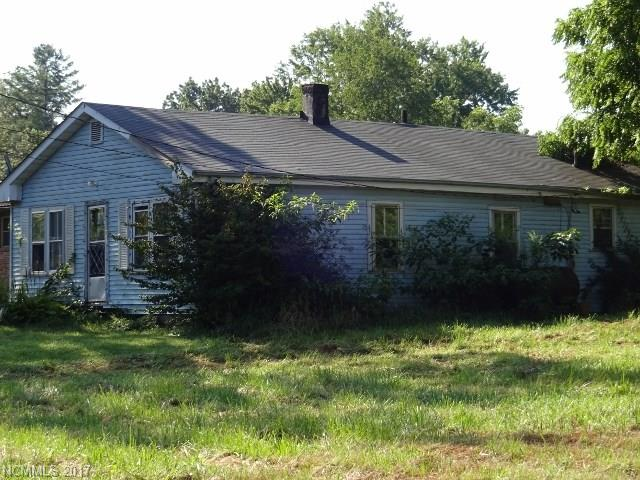 Close to downtown Hendersonville location with large lot.  House is being sold as-is.