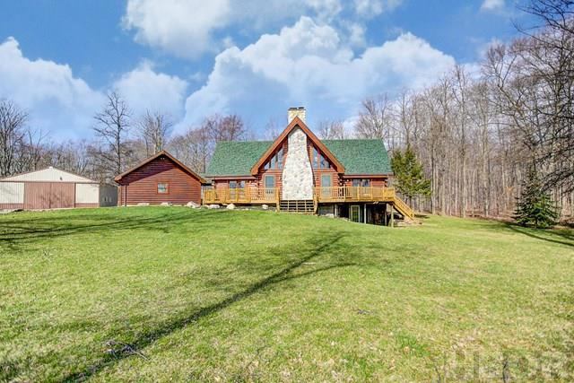 A Rooney & Associates listing. Log home with approx 29 acres. Home features 3 BR's, 3 full baths, walk-out unfinished basement. 9+ Acres being farmed, home sets on 19+ acre parcel, some woods with hiking trails and large 63x45 pole barn with concrete floor and wood burner. Garage is 36x24. Improvements since 2013 include: windows, roof, exterior staining of home, light fixtures and exterior door. Nice setting, private location. Call Charlie to view at 419/722-0848.