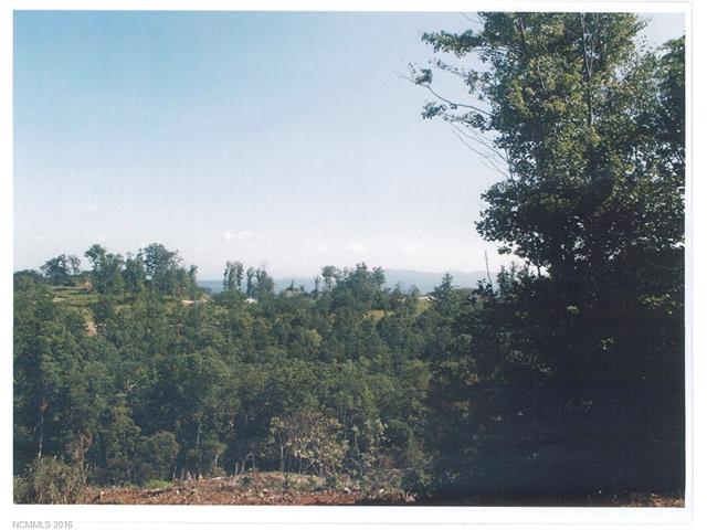 Beautiful wooded lot with long range views. Close to culdesac.