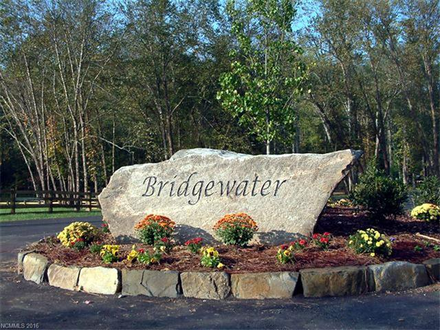 Beautiful wooded building lot in premier gated community of Bridgewater.  One of Asheville's hidden jewels just off the beaten path yet minutes to DT Asheville.  Lot is very easy build with perfect grade for walk out basement.  Underground utilities, water and natural gas.  Community offer 3 parks, abundant walk trails, community pavilion, fire side area and playground.
