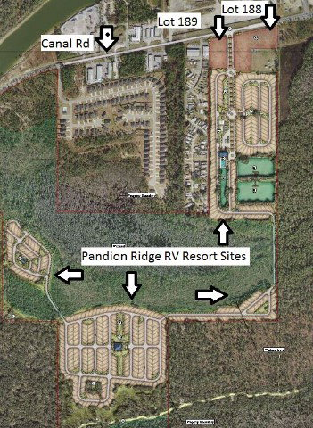 Commercial Development lot in Orange Beach on Canal Road at the Entrance to the new Pandion Ridge RV Resort. The L-shaped 4.12 +/- Acre corner lot has 520' +/- of Frontage on Canal Road.