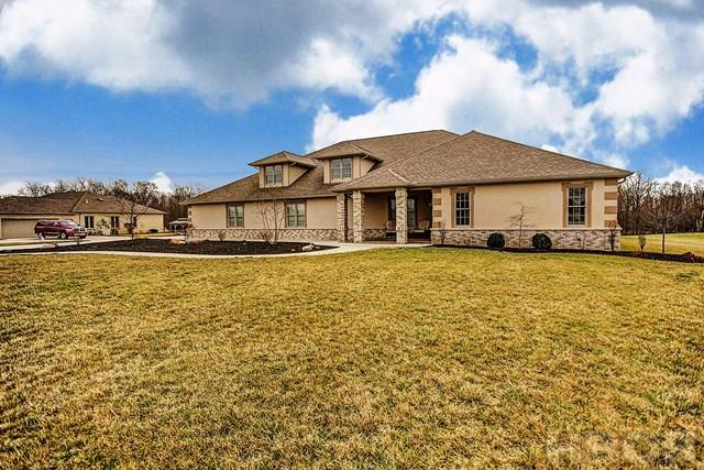 "ROONEY & ASSOCIATES REAL ESTATE LISTING.  Please contact Kim Cameron at (419)306-7823 or Brian Whitta at (419)701-4040 to schedule your private tour.  NO NEED FOR A BASEMENT!  This custom built John Vorst home offers a 46' x 50' garage that is heated and cooled, surround sound and LED lighting  PLUS a separate building that is a ""man cave"" for additional entertaining.  The house is like brand new and offers an open floor plan that showcases cathedral ceilings, crisp white woodwork and neutral decor.  The cook's dream kitchen offers ample custom Vorst cabinets, granite coutertops, stainless steel Viking appliances and a wine cooler. Spacious bedrooms.  The work out room could be converted into a family room.  Both bathrooms offer tile showers.  Covered patio PLUS a paver patio overlooks the 2 acre back yard and creek.  The ""man cave"" features a beautiful custom bar.  $1000 annual HOA fee covers pond maintenance and lawncare of the common areas."