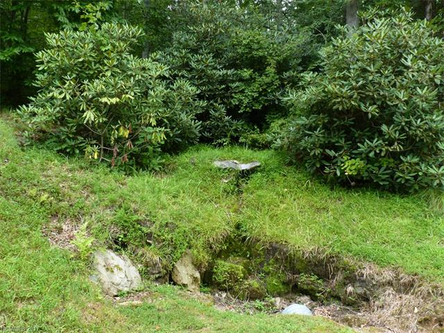 Lovely gentle sloping lot with beautiful hardwoods. Easy building site for lower cost foundation. Champion Hills is a friendly, member owned community with all amenities completed & large cash reserves. Only 5 miles to downtown Hendersonville & the Fresh Market. City water, community sewer system, natural gas, underground utilities & 24 hour roving security. A truly wonderful place to call home!