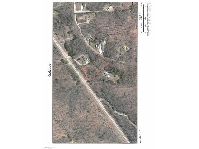 Great private building site with 1.87 +/- acres, off frame modular homes allowed, driveway in place, home-site cleared. Convenient to I-26.3BR septic system installed, This one is ready to go.