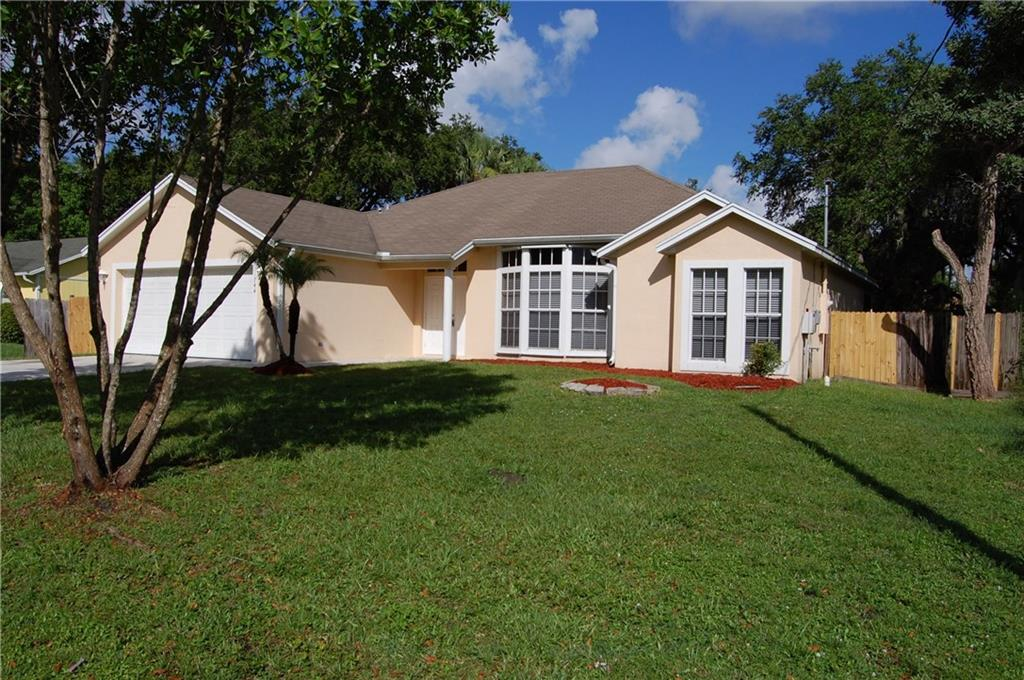 Check out this spacious CBS constructed home with 3 bedrooms, 2 baths, and a 2 car garage in Port St. Lucie very close to Traditions with all the shopping amenities you will need! Beautiful fenced in backyard with a large screened in patio that has room for a pool. Inside the home features newer white shaker cabinets in the kitchen, stainless steel appliances and laminate flooring throughout. Great opportunity so don't miss out!