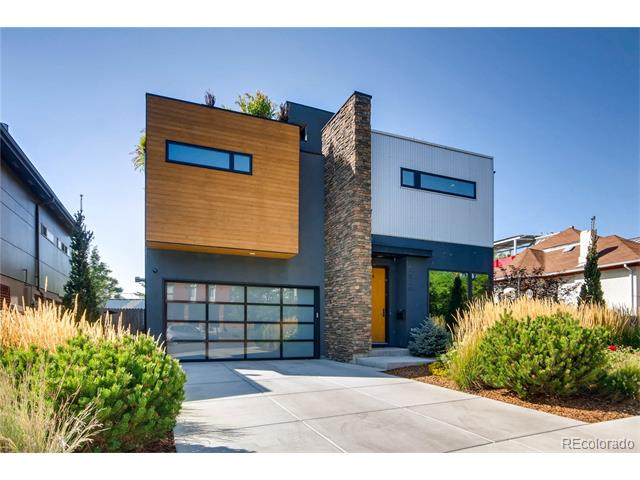 """Rare opportunity to own one of LoHi's true architectural treasures. Featured in Modern in Denver & Luxe Colorado Magazine, this thoughtfully curated, single family is one of a kind. Main floor features large living & dining areas, fireplace, powder bath, chef's kitchen & abundance of natural light. The master suite boasts floor to ceiling windows w/ smart window coverings, limestone master bath w/ steam shower, infinity Kohler Sok Tub, master deck w/ city views & large walk in closet. Guest bedroom, office and full bath down the hall. Finished basement currently used as media room complete w/ Epson laser 4k projector, 128"""" screen, surround sound, built in turntable w/ vinyl storage & wet bar can easily double as a 3rd bedroom guest suite. Attached garage w/ workshop, heated sidewalk and driveway. Backyard w/ raised garden beds, outdoor lounge w/ fire pit, 900 sqft rooftop trex deck, 8 person hot tub, rooftop succulent garden and unobstructed city & mountain views."""