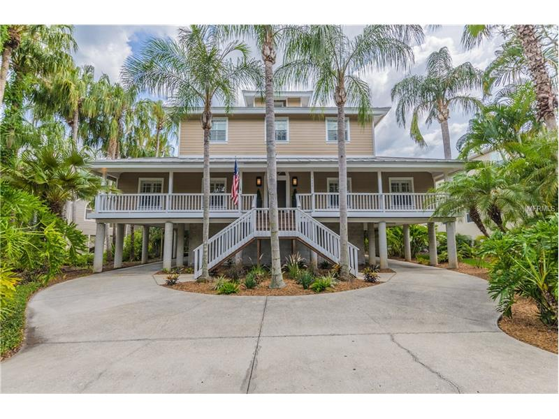 """PRICE JUST REDUCED BY $51,000 - WOW - TIME TO BUY! View Picture Gallery, Video and 3D Virtual Tour. Key West-Florida LifeStyle Home in Beautiful South Tampa's Ballast Point-Tampa Yacht Club Area """"Where the Grand Oaks meet the Bay"""". Custom Designed & Built. Double stairs exterior front entry to long covered front porch. 2nd & 3rd level Open Floor Plan w/Wood Floors & Pine Wood Post-Beam Vaulted Ceilings used thru-out the home + columns make elegant statement. Large Foyer-Stairs area. Liv Rm-Din Rm Combo, Kit-Fam Rm combo, SS Appliances, Island, 2-sided Breakfast Bar, Multi French Doors line Fm. Rm w/wood burning FP. Wide exterior rear covered screened porch overlooking Tropical Garden. 1st Floor LA includes 2 BR/1.5 BA/Laundry Rm. Up the beautiful stairs find double door entry Master Bedroom, look up to vaulted Pine Wood Ceilings into the Cupola - see motorized louver ventilation system. Enjoy serene Master Bedroom setting & Master Bath. Top floor includes 4th BR. Stilt Home is built on 30 poured-in-place concrete columns. Ground Level has 2 sided-split carport tandem 4 parking areas, storage/workshop/utility room, studio room w/1/2 bath, outdoor workshop pad, walkways, covered rear entrance steps to LA & serene outdoor deck-landscape. Hardie Board Siding. Come enjoy easy living, work, play - Walk, Skate, Bike & Stroll on Bayshore's Longest Sidewalk in the USA, Near Downtown Tampa, Ballast Point Park & easy access to restaurants, shopping, Tampa Int'l. Airport, St. Pete Downtown & our Florida Gulf Beaches!"""