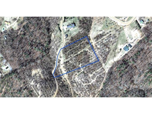 Peaceful and private setting on 4 plus private acres with year round long range mountain views. Easy build gentle sloping lot to build your dream home or mountain getaway. Restrictive covenants. Modulars welcome with approval. Convenient to shopping, restaurants, schools and Historic Downtown Hendersonville.