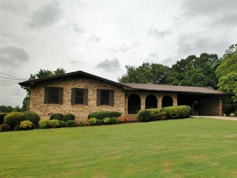 Well maintained brick ranch on a large lot just minutes from Oakwood and Gainesville. Don't miss this one! So much potential as a first time home, or investment rental in an older established neighborhood. This home has an open kitchen/dining room/den area as well as a large formal living room.