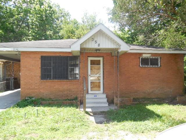 Raised brick cottage with partially fenced rear yard. Large Eat in Kitchen with additional Dining room. Good sized bedrooms. Attached covered carport with Enclosed Laundry area.