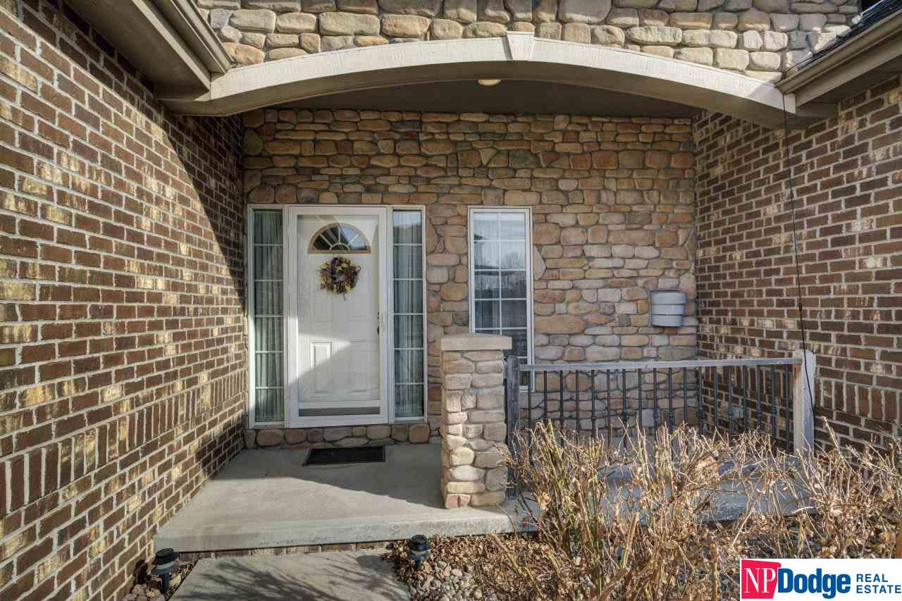 Here's the one you've been waiting for!  Beautiful Papillion Ranch with a 3 car side-load Garage on spacious corner lot!  Bright and open with 9' ceilings and rounded corners throughout. This rare floor plan is buyer favorite with 5 Bedrooms (all have walk-in closets!) + 3 Baths... ALL on MAIN LEVEL!  Cozy angled stone Fireplace (pre-wired for your flat screen tv!) with an open view to a nice sized Dining Area with a trey ceiling. Spacious Kitchen is perfect for entertaining; new granite countertops, gorgeous backsplash, wood flooring, birch cabinets with self-close drawers and pull out shelving, pantry and a huge center breakfast/prepping island. Private Master's Suite is located on its own side of the house and includes; lighted trey ceiling, dresser nitch, and a walk-in closet. Master Bath with his and her vanities, tile surround jetted spa tub, and a shower with a seat and a relaxing upgraded shower head.  Nice sized main level. Laundry near the Master Bedroom connects to a half bath.  Nice wide entryway from Garage with plenty of room for a drop zone area.  Large, out-of-sight, staircase leads to a Finished Lower Level with a huge Rec Room, True/Conforming 5th Bedroom with a large closet and above ground window boasts its own private ¾ Bath.  Plenty of additional space for storage or to further expand the basement including a large room with windows and a door that could be used as an exercise or theatre room, plus another XL Storage Area (or future additional square footage!).  Professionally landscaped yard, decorative concrete sidewalk, deck overlooking yard with white PVC fencing.  Power Humidifier, sprinkler system, soffit with built-in plugs for holiday lighting, and a 1 Year Home Warranty offered.  Great location near schools, amenities & Offutt AFB.