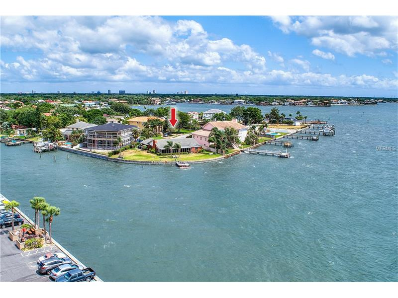 This 1963 home was built on a pie shape lot that is overlooking beautiful Tampa Bay. You will enjoy the waterfront view and the accessibility to your favorite water toys on your own private dock. The house is a single story, 3 bedrooms, 2.5 baths that features a wood burning fire place with an outdoor kitchen and covered patio. The house would be perfect as a fixer upper or tear it down and build your dream home. The nearby schools include Grady Elementary School, Coleman Middle School and Plant High School.