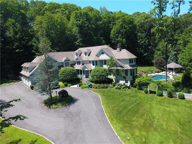 Custom built home w/careful attention to architectural design, detail & craftsmanship! Wonderful open floor plan w/ large gracious rooms - perfect to spend time w/ family or to entertain friends. Start the party off in the large 2 story family rm with floor to ceiling stone FPL that opens  to the deck or pass by the wet bar, grab a drink & spend some time on the screened porch overlooking the perennial gardens & pool. Then there's the huge kitchen where everyone always ends up! This home has it all; character, an abundant amount of space, high ceilings, a perfect floor plan, BDRMS ensuite, guest rms, rm for a gym, LL game /theater room, gunite pool w/spa, outdoor kitchen w/surround sound, privacy & it's on a cul de sac! Please see addendum.