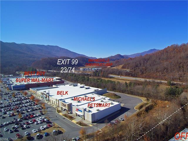 Remarkable location and opportunity adjoining Waynesville Commons (Super Walmart Center) with 27+ acres and over 389,800 square feet in office and warehouse with rail service. Updated environmental, roof, wet/dry sprinkler system, and more. Prime location for future development, bordered by Ingles, PetSmart, and more.