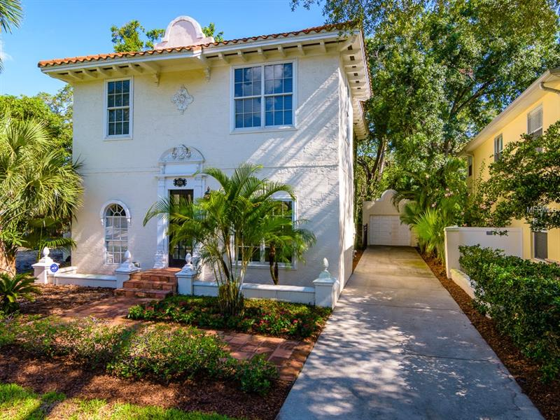 This South Tampa gem is in the much sought after neighborhood of Virginia Park. Upon entering you will be taken by the high ceilings and architectural details that are present throughout the house. An inviting living room and dining room combination present a warm welcome. The kitchen is reminiscent of a French country house complete with island and a breakfast nook, the perfect spot to enjoy a croissant and café au lait. Featuring top of the line appliances and a walk in pantry this is sure to please the fussiest of chefs.  The family room features a climate controlled wine storage room, beautiful ceramic tile floors and French doors that lead out to the courtyard. The master suite on the second floor features a fireplace, two walk in closets and en-suite master bath with double sink vanity furniture, walk in shower, and jetted garden tub. Enjoy the ambiance of your own courtyard with a fountain and built in grill, providing a  lovely spot to entertain friends and family and enjoy nature. Recent updates include AC and Hot Water heater within 2 years. Convenient to top rated schools, shopping, restaurants, and entertainment. Easy access to major highways, Downtown, TIA and area beaches.