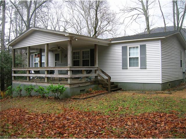 Neat and clean manufactured home with great view. Rear deck, large front covered porch and separate storage building/workshop.  All furniture, appliances, dishes, everything with exception of a few personal items is included with sale.  Very private and secluded.  No road maintenance agreement.  Recent new well, new roof in 2014. 2 bedroom septic system.