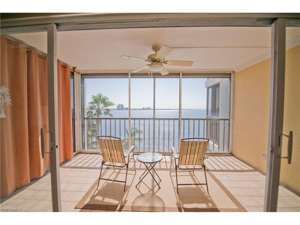 Enjoy breathtaking panoramic views of the Caloosahatchee River from your kitchen, living room & lanai.  This 6th story end-unit offers a ton of natural light & has undergone thoughtful updates, including: remodeling bathrooms with gorgeous tile work, improving the kitchen from its original design & installing hurricane rated impact windows.  All pictured furnishings are included.  New water heater. You will fall in love instantly with the amazing, unrivaled views of both downtown Ft Myers & miles of open river clear to Veterans Bridge.   North Shore Place is an immaculately maintained 2 building condo community, located on the North Shore of the Caloosahatchee River, offering a fantastic pool, hot tub & grill overlooking the river, tennis courts, remodeled & fully equipped exercise room w/ a sauna,  lighted dock w/ seating, community room, bike storage, covered parking & storage sheds. Marina Town is a short walk & offers several waterfront bars & restaurants. $380 HOA fee includes water! Don't Delay! You don't want to miss these views, or this opportunity to buy in paradise.