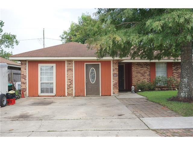 Nice sized home with very large entertaining area, corner brick fireplace. House has lots of potential.
