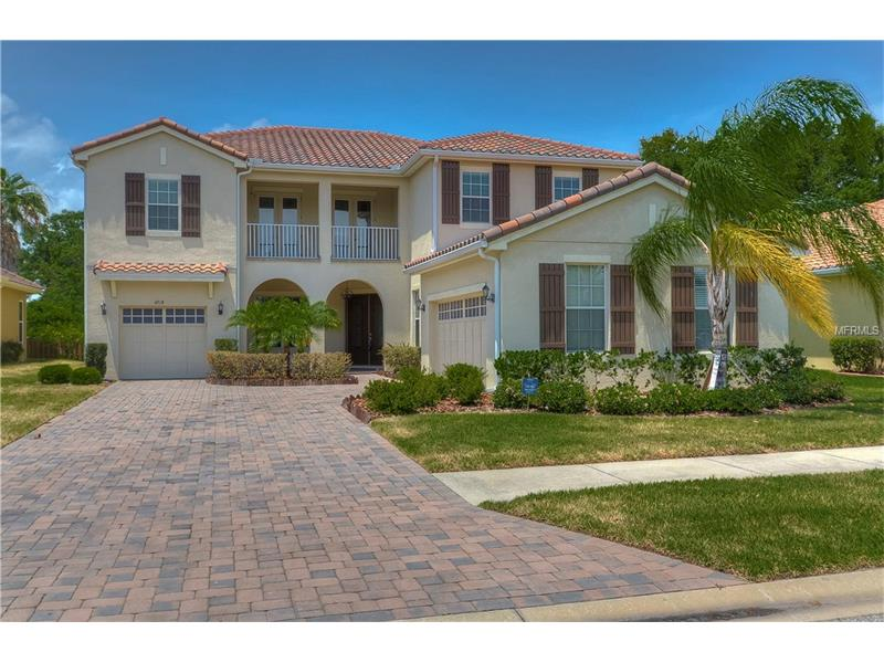 Impeccably maintained 5 BR/3 BA/3-Car garage home in the gate community of WATERS EDGE. Great Tampa location! This tastefully built home has the floor plan to accommodate the whole family!  A large grand foyer that is open to the great room that sports popular sliding barn door window coverings and sliders to the screened lanai. Also downstairs, a formal dining room and a kitchen that includes a separate breakfast nook, breakfast bar, island, closet pantry & Butler's pantry with beautiful wood cabinets, granite counters, tile backsplash and stainless steel appliances for your chef to enjoy! A great space for family and friends to gather while entertaining! A guest suite downstairs and four bedrooms upstairs. The 2nd level master retreat is complete with garden tub, large glass enclosed tile shower, his & her vanities & walk-in closets. Two more bedrooms upstairs have a Jack & Jill bath w/dual sinks and the 5th bedroom easily doubles as a media/game room. You'll love this 3 year new home that has hardly been lived in. Location is key! Close to dining, retail, medical facilities. Easy access to major highways, Tampa International Airport, MacDill AFB and only a short drive to the beaches and downtown Tampa! Call today before it's gone!