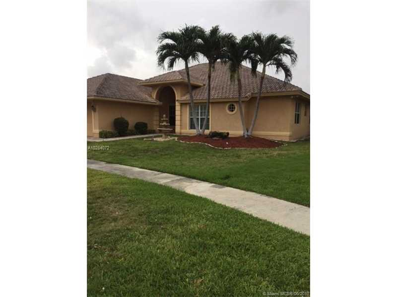 Large 4 bedroom 3 bath home which backs up to the old Golf Course and sits on a cul-de-sac.  Main living area has tile throughout.  Very spacious home in Boca Raton.