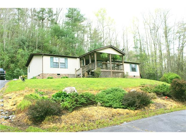 Private 2 acre upgraded manufactured home less than 1/2 mile from Holmes State Forest. Kitchen Island, Hardwood floors, Porch on front, Deck on back. Nice spa tub in master.