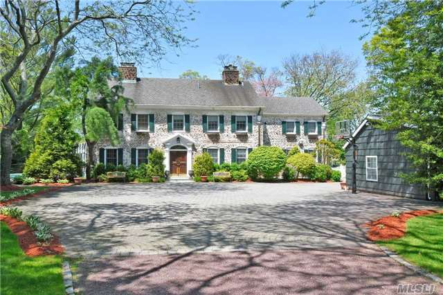 Exquisitely Restored Brick Manor Estate, On Over 2 Acres With Heated Gunite Pool, Tennis Court, 200 Feet Of Bulkhead On Macy Channel With Private Dock. Outdoor Kitchen, 3 Car Detached Garage With 2 Additional Lifts.