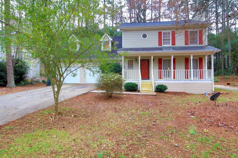 Charming 2 story home in Bethany Woods subdivision with private fenced in backyard~tile foyer and kitchen~new paint~new HVAC~bonus room~gas water heater~separate tub and shower~stove and refrigerator included~hardwood floors~fireplace in living room~2 car garage~quiet neighborhood with Gwinnett county schools~NO HOA!~1 year home warranty included!~transferable termite bond included~carpet allowance~MUST SEE!!