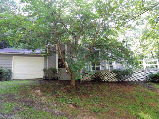 CUTE HOME ON A PRIVATE WOODED KNOLL, JUST LIKE A TREE HOUSE. GREAT SPOT FOR VACATION HOME OR FIRST TIME BUYERS. JUST NEEDS INTERIOR UPDATES! APPLIANCES LEFT AS COURTESY. TWO LOTS WITH 25' ROW TO SECOND.