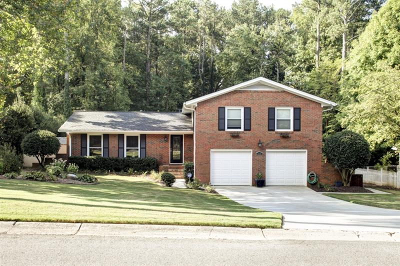 Updated home on quiet street in Tuxedo Estates n'hood. Kitchen feat s/s apps,granite counters,tile backsplash,pantry,& wine rack. Light & bright liv rm opens to din rm. Lower lvl boasts fam rm w/ FP & built-ins & bath w/ soaking tub. Master has custom closet w/ marble island & spa-like bath w/ dble vanity, walk-in shower, & marble detail. Add'l bdrms well-sized & bright. Amazing outdoor space includes covered Trex deck w/ dual sided FP,raised organic garden beds,& out bldg w/ electricity & AC. 2 car garage.Great location convenient to interstates,shopping,& restaurants!