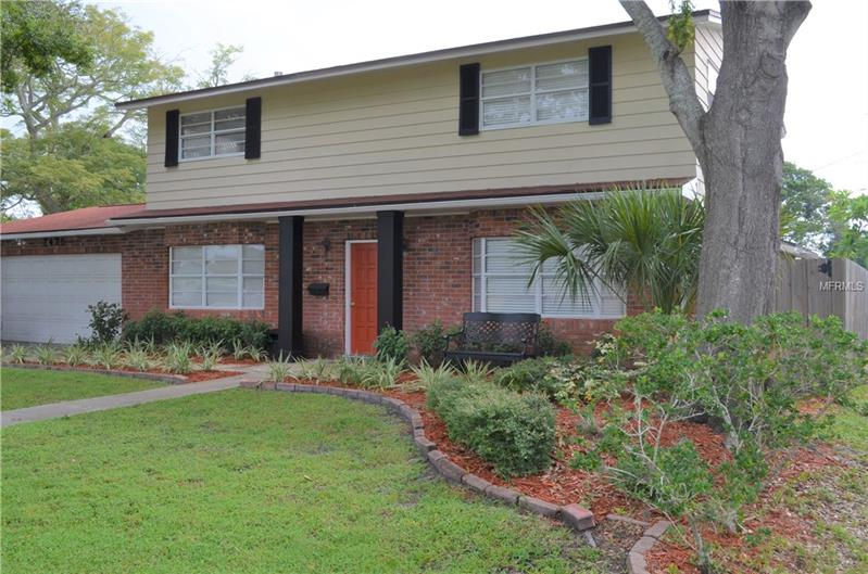 The perfect home in Northeast St. Pete has plenty of bedrooms, living space and a large 2-car garage.  Kitchen and baths have been updated and there's great backyard space for entertaining and play. This is a large house in a great neighborhood adjacent to Holy Family School. There are 4 large bedrooms upstairs including the Master Suite with updated granite vanity and cabinetry. An additional full bath services the other upstairs bedrooms and a powder room or half bath is available downstairs. There are 3 large living areas and a Dining Room downstairs. The rear Family room is huge, has a natural gas fireplace and is perfect for watching the Big Game! French doors lead from the Family Room to the backyard. The Formal Dining room is off the kitchen and front foyer and accommodates a large table.  Located in a very convenient location off of 1st Street in Northeast St. Pete, within 10 mins of shopping, restaurants and thriving Downtown.