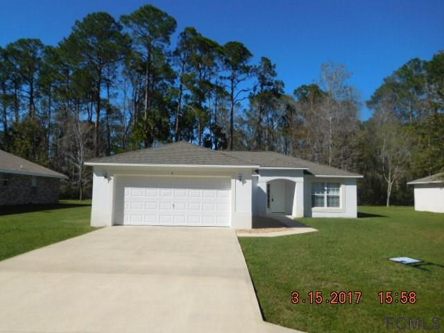 9 Poinsettia Ln, Palm Coast, FL 32164