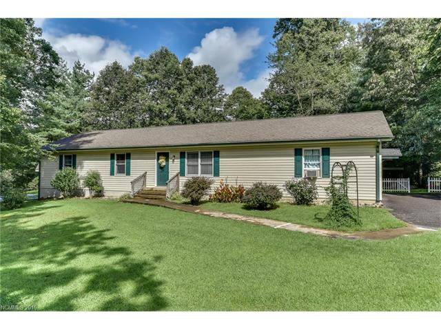 Peaceful country living but only minutes to town! 3/2 on large level, fenced lot with outbuilding.  This home features stainless appliances, formal dining and huge bonus room with fireplace.  Spacious master with double closets. Low maintenance vinyl siding plus laminate floors throughout most of home for easy living.