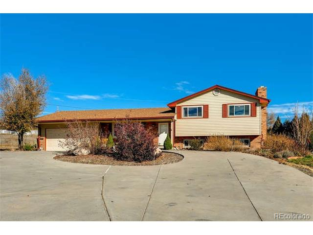 Beautiful updated home on over an acre! HORSE PROPERTY Fabulous views! Close to new light rail station coming to Arvada! Very spacious yet very private! Updated kitchen and bathrooms. Heated Sunroom! Entire property is fenced! Newer roof! New A/C. Well maintained and wonderfully cared for home in the perfect location!