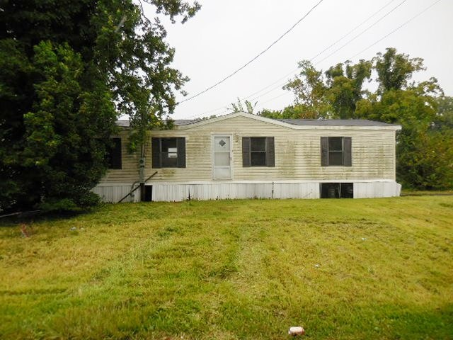 Double wide mobile home on 2 lots. Property has 2 driveways.  Mobile home has Large den area with fireplace and separate dining room. Master bath has garden tub and large walk in closet.