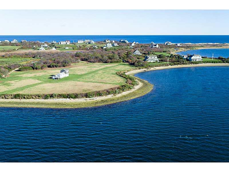 Drift down a private lane to this exclusive peninsula that surrounds you with marvelous Great Salt Pond views and an estimated 600 feet of water frontage.  This 6.7 acres of land offers enough space to site your dream home. Spectacular views.