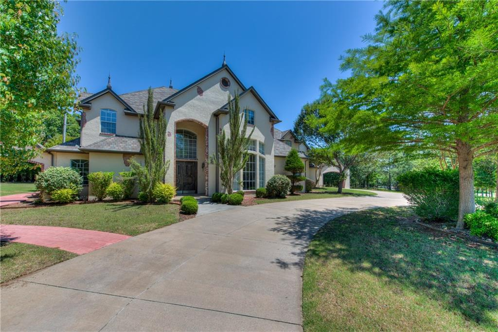 Must see estate in one of Edmond's most coveted communities! Set on 2 (mol) acres among a gorgeous, forested landscape, this home offers all the charm and privacy of country living, with only a few miles commute to I-35 and minutes from Edmond downtown. Step into elegance as you enter this wonderfully designed home with all the amenities you could ask for.  A grand entry with soaring ceilings, wood flooring and two way fireplace in the main living. Gourmet kitchen appointed with a massive center island, gas range, a walk-in pantry, and loaded with storage. Master suite is on the main level. Enjoy the amazing views from the upstairs balcony. The study with rich built-in bookcases, a huge game room, and all secondary bedrooms are upstairs. This home will absolutely embrace you at every turn! Make an appointment to view its style of timeless beauty. Welcome Home!