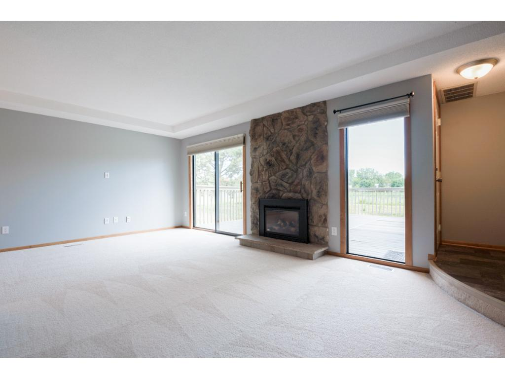 """Beautifully updated townhome w/prairie views. Living rm w/gas fireplace. New carpet & luxury vinyl tile flrs thru-out. Updated UL w/knockdown ceiling, white 6-panel doors & trim. Kitchen w/new hand scraped engineered flrs, 42"""" cabinets & pantry cabinet. Master suite w/walk-in closet. LL family/theater rm wired for projector screen & SS. Association maintained pool & playground! New roof in '17, water softener & water heater '11. Sellers offering an AHS Shield Plus one-year home warranty!"""